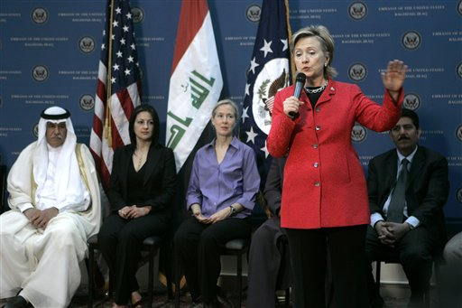 U.S. Secretary ofState Hillary Rodham Clinton, foreground, gestures as she speaks, with unnamed representatives of Iraqi civil society and embassy staff in the background, at a meeting at the U.S. embassy in Baghdad, Iraq, Saturday, April 25, 2009. Clinton on Saturday assured Iraq that the Obama administration would not abandon the country even as it presses ahead with plans to withdraw American troops amid a recent surge in violence. (AP Photo/Marko Drobnjakovic)
