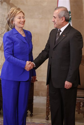 U.S. Secretary of State Hillary Rodham Clinton, left, shakes hands with Lebanese President Michel Suleiman, right, at the Lebanese Presidential Palace, in Baabda east of Beirut, Lebanon, on Sunday April 26, 2009. Clinton came to Lebanon Sunday with a strong message of support for the country ahead of critical elections.. (AP Photo/Hussein Malla)