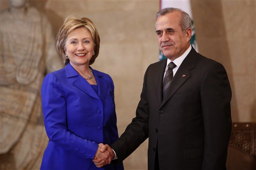 U.S. Secretary of State Hillary Rodham Clinton, left, shakes hands with Lebanese President Michel Suleiman, right, at the Lebanese Presidential Palace, in Baabda east of Beirut, Lebanon, Sunday April 26, 2009. U.S. Secretary of State Hillary Rodham Clinton met Sunday with Lebanon's president on a stop in Beirut ahead of a critical election that could see a pro-U.S. government ousted by the Iranian-backed Hezbollah and its allies. (AP Photo/Hussein Malla)